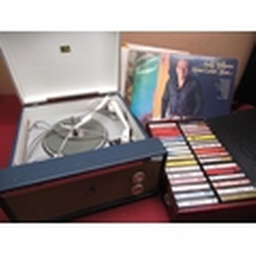 446 - HMV 2002 record player with a selection of various 12