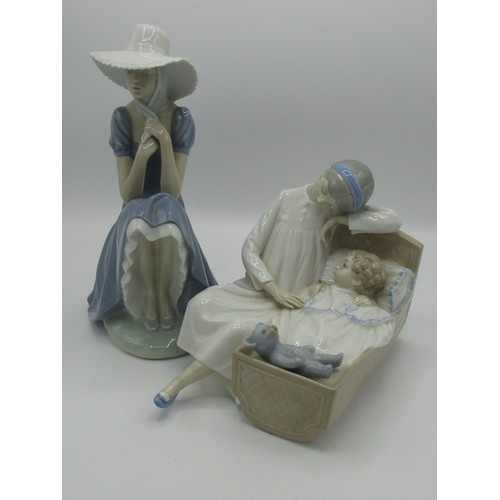 142 - Nao Lladro figurine of a seated lady and another of a mother and child in a cot...
