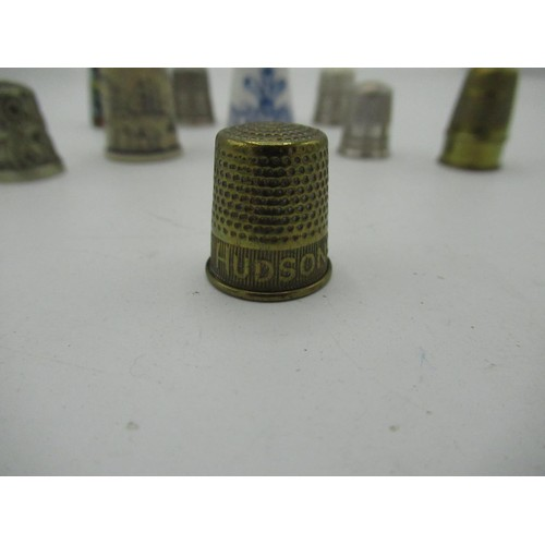 456 - Collector's thimbles including three silver and one advertising Hudson's soap