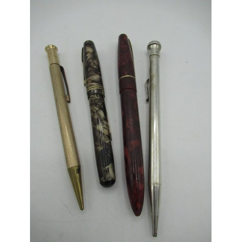 458 - Waterman's marble effect fountain pen, another fountain pen, a silver-plated Wahl Eversharp propelli...