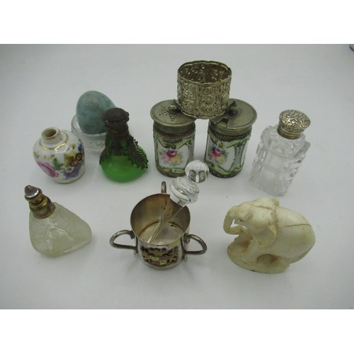 459 - Collection of scent bottles, a pair of condiment pots with floral design, an ornate white metal napk...