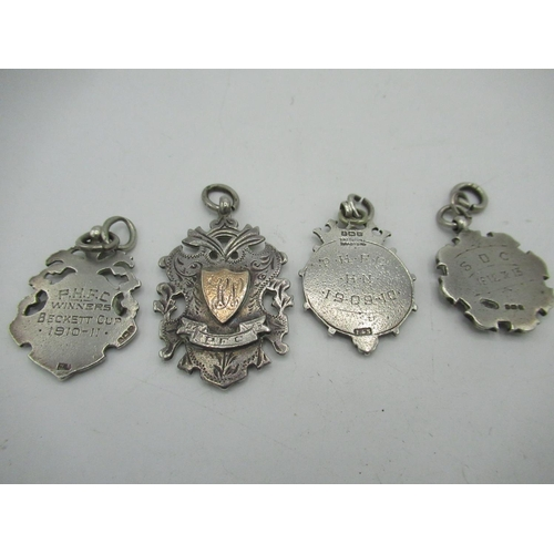42 - Edw.VII silver hallmarked Ryedale League fob medal, three Geo.V silver Beckett Minor League and othe...
