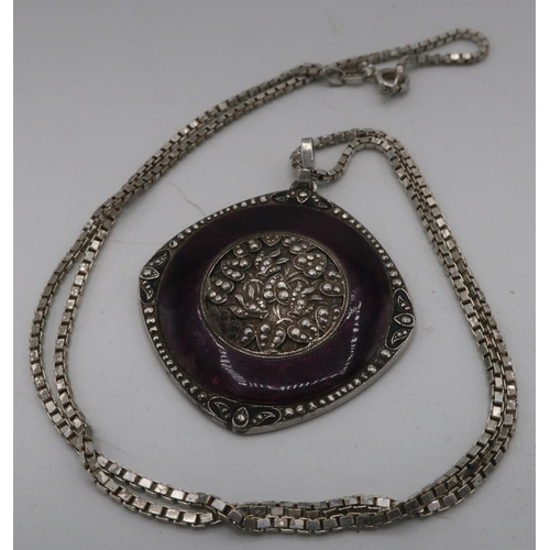 45 - Silver and purple enamel circular pendant with floral central panel, marked 935.000, silver chain st...