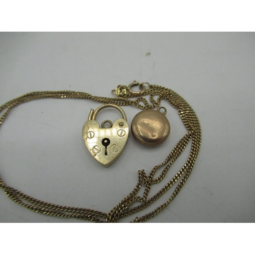 15 - 9ct gold heart padlock charm, yellow metal circular pendant and 9ct gold necklace with ibis pendant ...