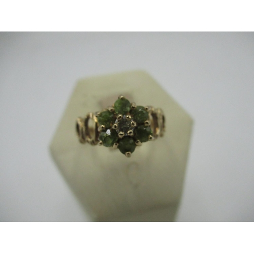 35 - Hallmarked 9ct gold peridot and diamond cluster ring, London, 1975  Size O, gross 2.9g