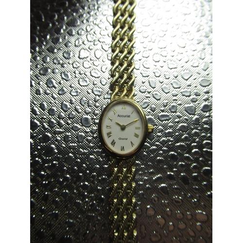 38 - Accurist quartz ladies cocktail watch hallmarked 9ct gold case on mesh style bracelet snap on back c...