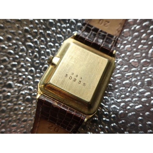 47 - Grath Quartz wrist watch. 14ct gold case on brown leather strap. Brushed gold case with snap on back...