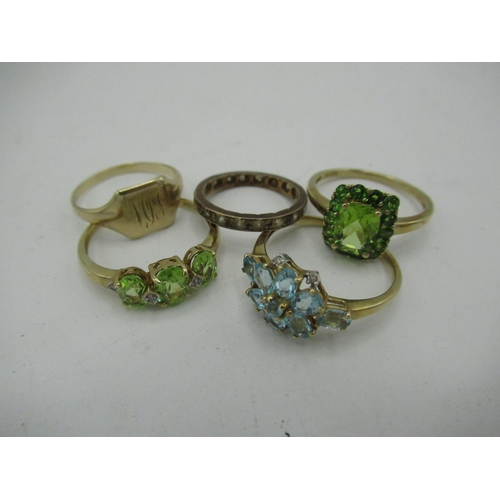 8 - 9ct gold Halo style peridot ring Size R, gross 2.8g and a 9ct gold aquamarine ring Size S gross 2.1g...