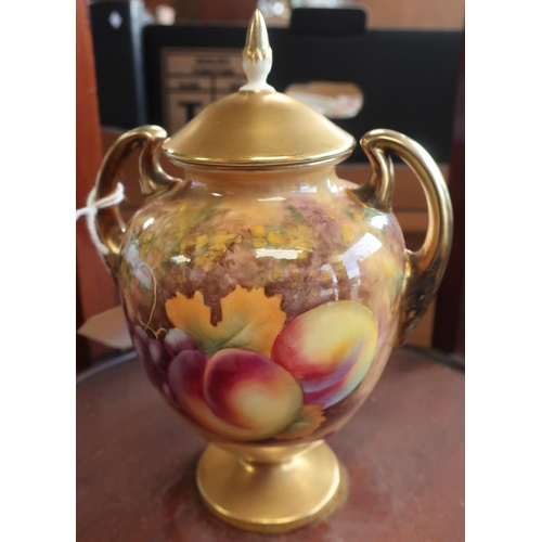 669 - Royal Worcester porcelain vase with urn shaped body with scroll handles, painted with pictures and b...