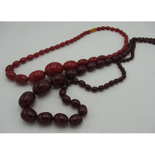 98 - C19th red amber graduated bead necklace, L30cm and a C19th ruby amber graduated bead necklace L46cm ...