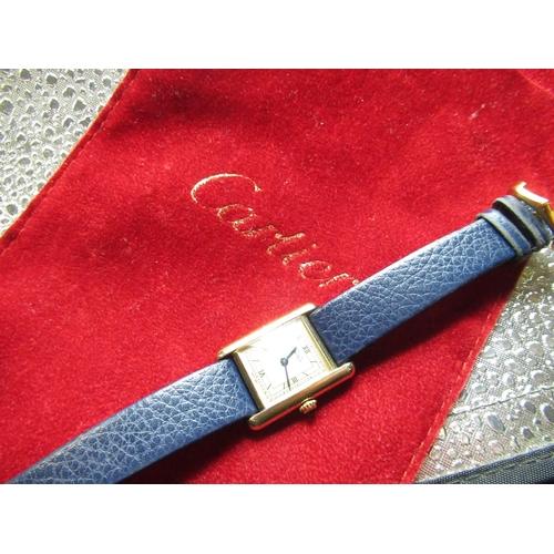 19 - Ladies Cartier Argent quartz gold plated wristwatch, rectangular case on later blue leather strap, t...
