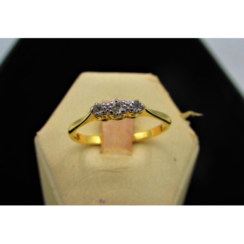 18a - 18ct gold three stone diamond ring Size T stamped 18ct, 2.8g gross