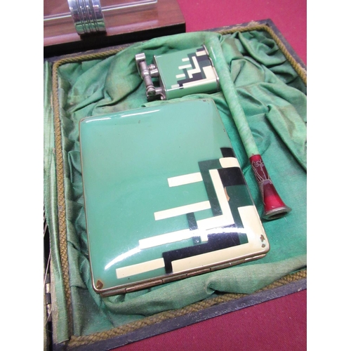 102 - 1930's green enamel three piece cased smokers companion comprising cigarette case, Dunhill style lig...