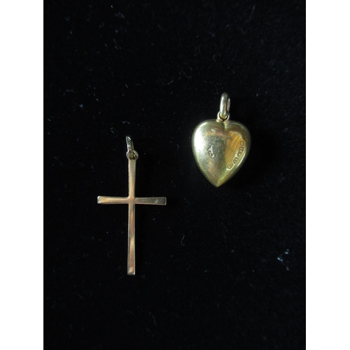 12 - 18ct gold cross pendant stamped 750 L3cm, a 15ct gold heart shaped pendant with inset diamond hallma...