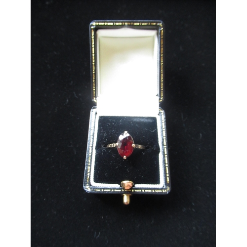 18 - 9ct gold garnet oval singled stone ring stamped 9ct Size K 2g
