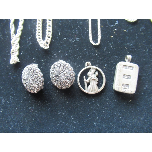 30 - Collection of silver chains, pair of silver clip on earrings inset with marquisates, silver St Chris...