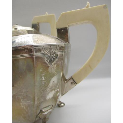 36 - Geo. VI Art Deco design silver four piece tea set. Comprising of a coffee pot, teapot with angular i...