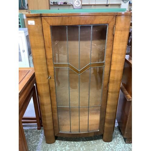 117 - 1920's deco walnut china cabinet enclosed by single lead glazed door