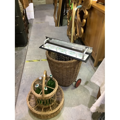 134 - Mid C20th wicker shopping basket, drinks basket with various bottles and mid C20th kitchen tarback s...