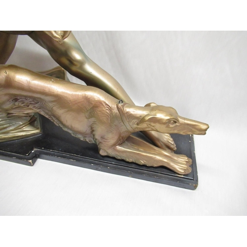37 - Art deco figure of a man and hunting dog