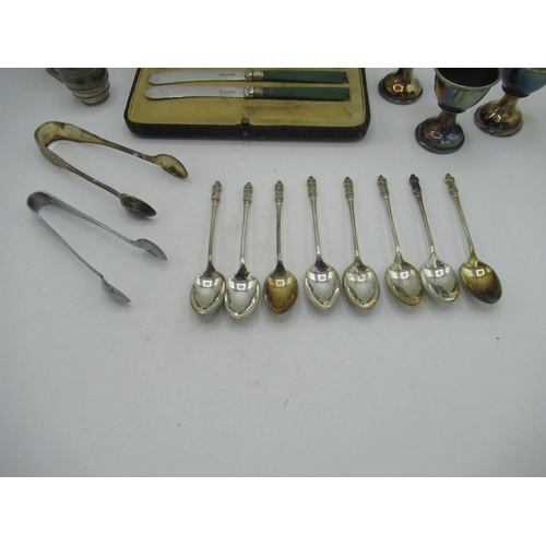 43 - Cased set of five green handled knives, eight apostle tea spoons, salt and pepper set, two pairs of ...