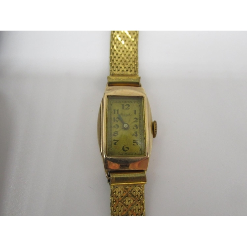 12 - 9ct gold Ladies wristwatch with hand wound Swiss made with mother of pearl dial, 15 jewel movement o...