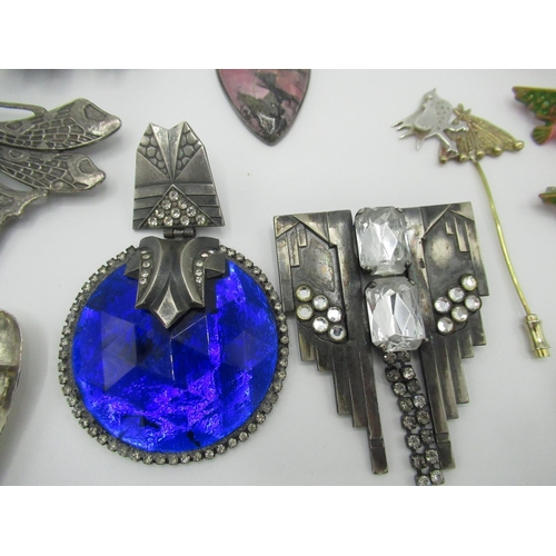 34 - Collection of costume brooches including one abalone circular brooch with foreign stamp to back, a h...