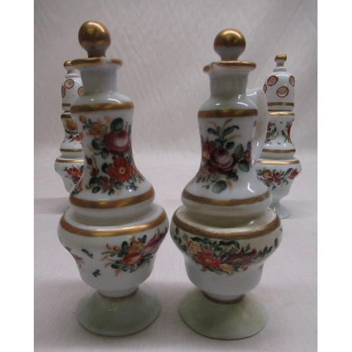 26 - Pair of C19th Dutch opaque glass casters with hand painted floral decoration, pair of matching oil b...