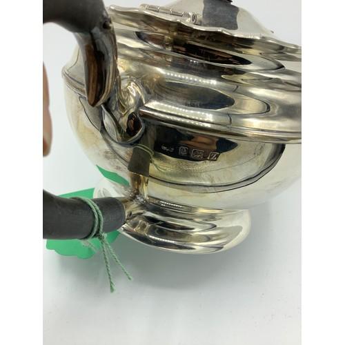 6 - Geo.V silver teapot, ebony handle and finial on circular stepped foot, Birmingham 1924, H13cm.