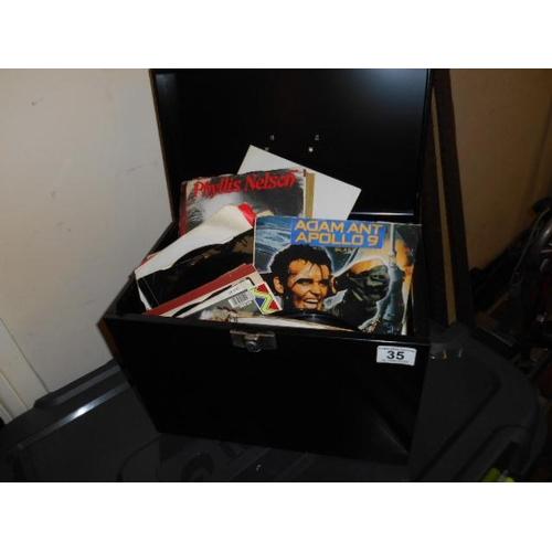 35 - Tin box and 45s...