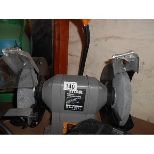 140 - Titan bench grinder and light...