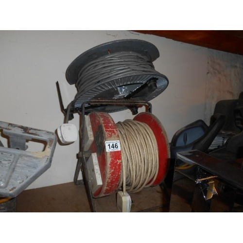 146 - Pair of extension reels...