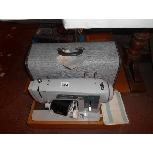 253 - Frister + Rossman electric sewing machine and case...