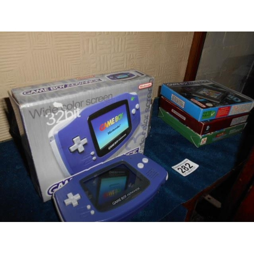 282 - Game Boy Advance + games + accessories- working order...