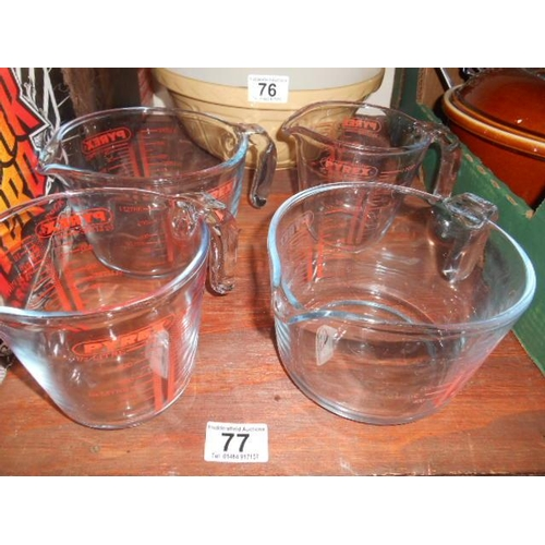 77 - 4 original Pyrex jugs...