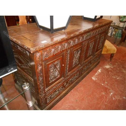 47 - Carved oak coffer...