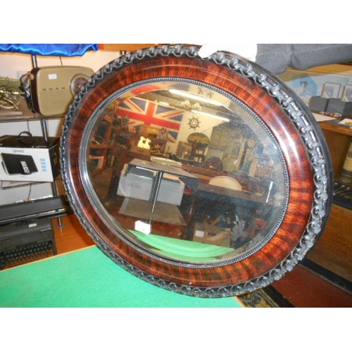19 - old bevelled oval mirror...