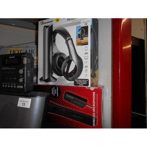 12 - Boxed wireless headphone and karaoke microphone...