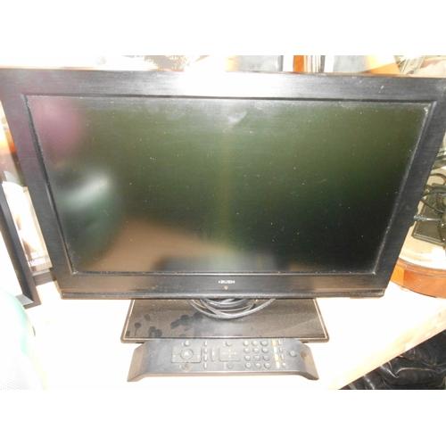 47 - Bush mini LCD TV and remote...