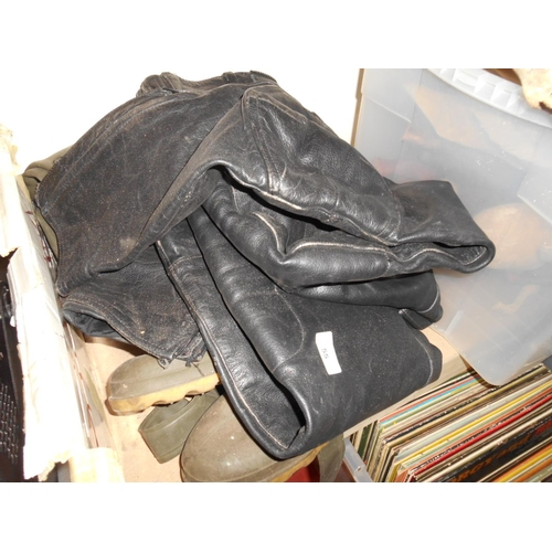 55 - Selection of motorbike leathers and waders...