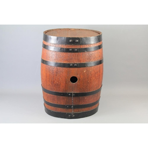 A Large Oak Aged Wooden Beer Barrel The Barrel With Cast Iron