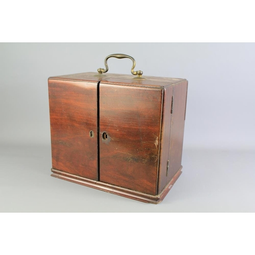 1 - A Victorian Mahogany Travelling Apothecary Chest. The double doors open to reveal two rows filled wi...