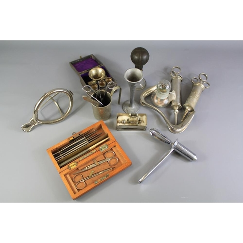 21 - A Quantity of Interesting Vintage Medical Equipment. This lot includes a S Maw & Sons Scalpel Set, a...