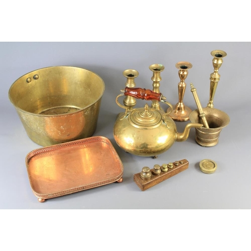 57 - Miscellaneous Vintage Brass. This lot includes; a brass pestle and mortar, two pairs of candlesticks...