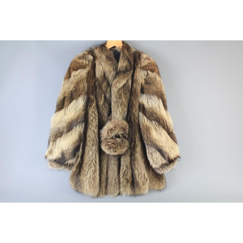 58 - A Ladies Vintage Raccoon Short Jacket. This lot includes a pair of matching ear muffs, approx size 1...