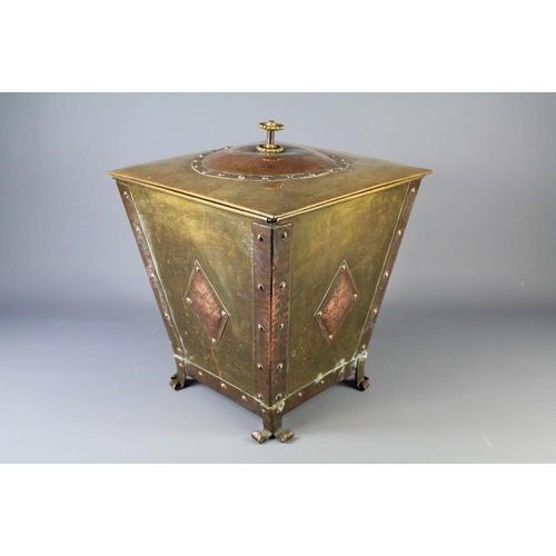 61 - An Arts and Crafts-Style Coal Bucket. The brass bucket with copper studded edges, diamond-shaped dec...