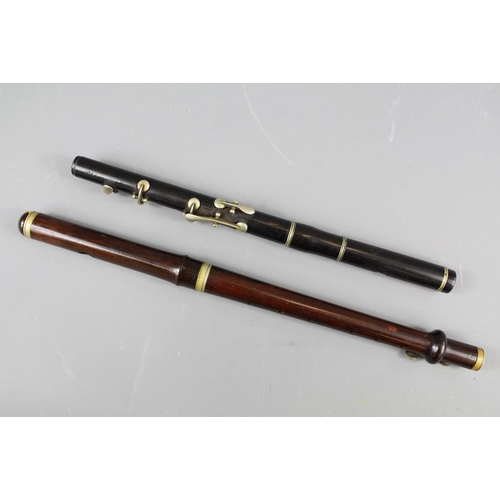 33 - Antique Rosewood Flute. The flute with brass fittings approx 38 cms together with a black-wood flute...