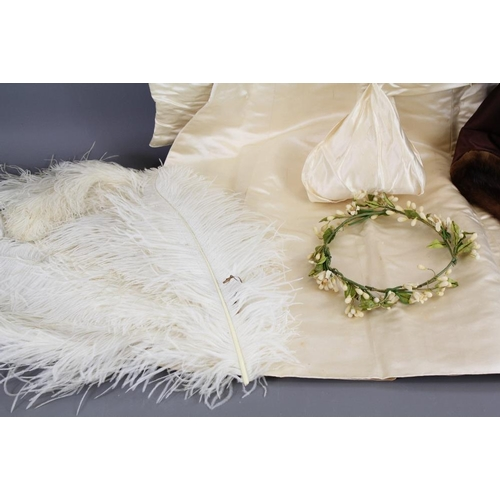 40 - A Silk Wedding Gown. The gown complete with veil and floral tiara, this lot includes a mink stole, m...