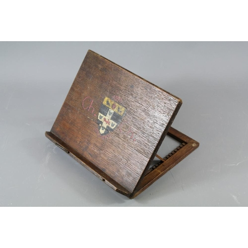 56 - An Oxford University Book Stand. The book stand painted with the university motto, inscription to th...