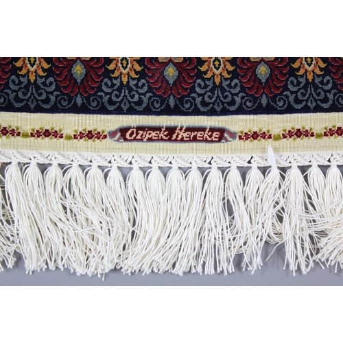 90 - 21st Century Ozipek Hereke Silk Carpet, one of the finest carpets in this size, approx 31 x 23.5 cms...